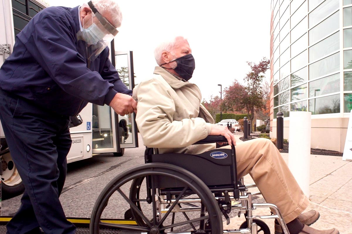 RTP Driver helping man in a wheel chair onto bus